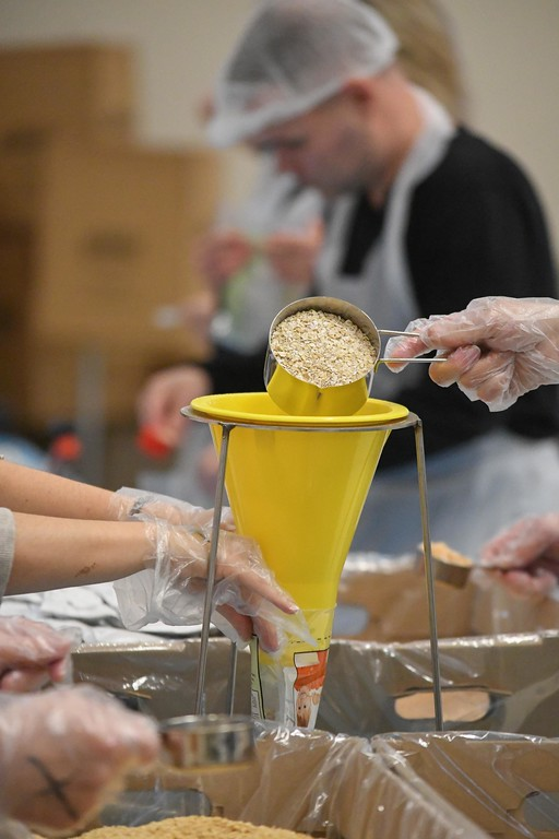 . Eric Bonzar�The Morning Journal<br> Volunteers from across the county came out to Lorain County Community College\'s College Commons, Jan. 22, donating an hour of their time to help package fortified apple and cinnamon oatmeal during the Americorps\' Martin Luther King Jr. Day Meal Packaging event. Teams of 10 or less helped package the warm breakfast cereal, for distribution, in an effort to combat food insecurity in Lorain County.