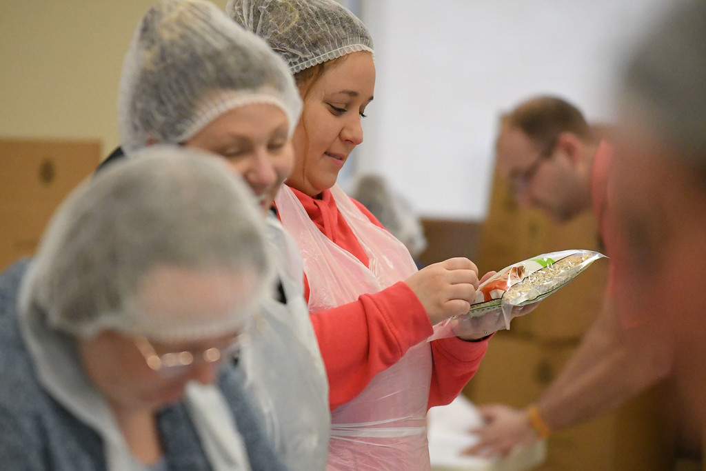 . Eric Bonzar�The Morning Journal<br> Nursing student Franny Cortez labels packages of fortified apple and cinnamon oatmeal, during the Americorps\' Martin Luther King Jr. Day Meal Packaging event, Jan. 22, 2018. Volunteers came to Lorain County Community College\'s College Commons, donating an hour of their time to help package the warm breakfast cereal in an effort to combat food insecurity in Lorain County.