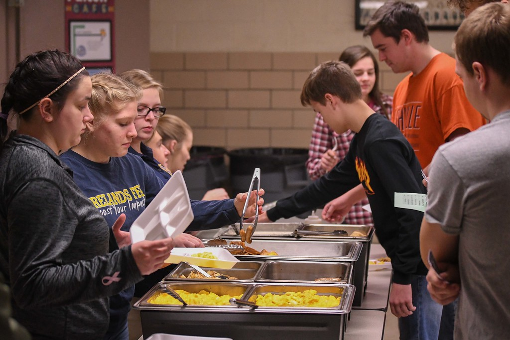 . Eric Bonzar�The Morning Journal<br> Members of Firelands\' Future Farmers of America serve breakfast to student leaders during a Hunger Breakfast simulation, Feb. 6, 2018. The simulation was held to educate their peers about food insecurity in their school and community.