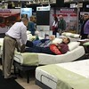Checking out a product at the Sleep Number exhibit