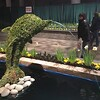 Dolphin-shaped topiary in passageway to Garden Showcase.