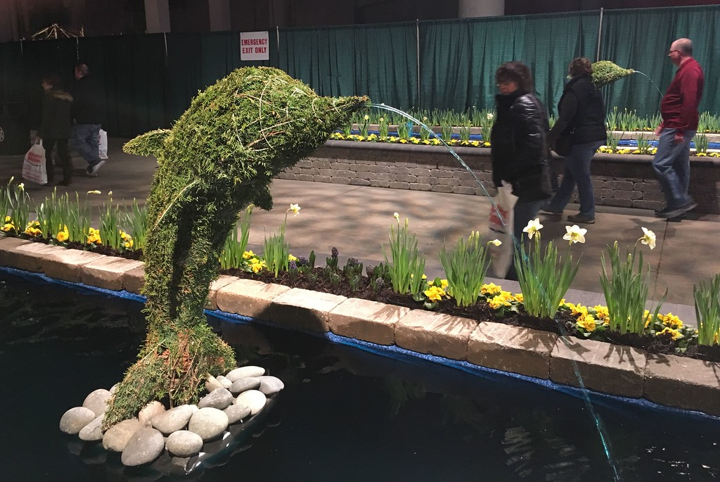 . Dolphin-shaped topiary in passageway to Garden Showcase.
