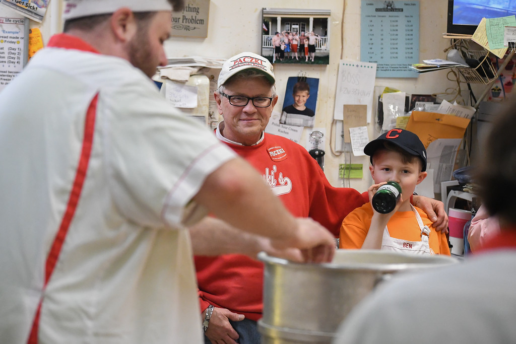 . Eric Bonzar�The Morning Journal<br> Tim Kiedrowski and 10-year-old Ben Kiedrowski take a moment to soak in the P�czki process, Feb. 13, 2018.