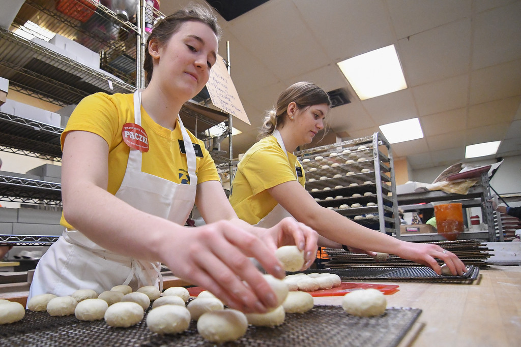 . Eric Bonzar�The Morning Journal<br> Missionaries Sister Page, left, and Sister Bailey of Salt Lake City, tray up p�czki dough balls during Kiedrowski\'s Simply Delicious Bakery\'s Fat Tuesday celebration, Feb. 13, 2018.