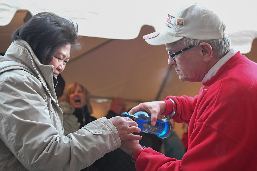 . Eric Bonzar�The Morning Journal<br> Tim Kiedrowski helps patrons in line stay warm with shots, as they wait to get inside to place their order, Feb. 13, 2018.