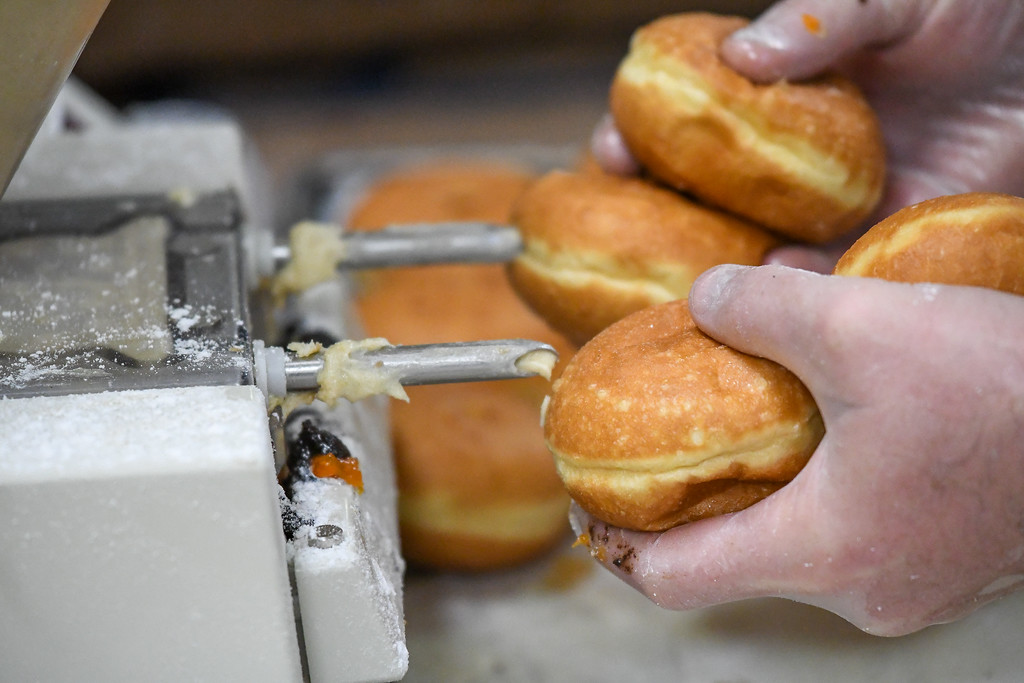 . Eric Bonzar�The Morning Journal<br> Kiedrowski\'s Simply Delicious Bakery rounded out its five-flavor p�czki selection with a new flavor,  Edelweiss, for its Fat Tuesday celebration, Feb. 13, 2018.