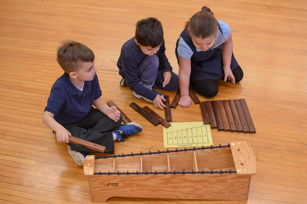 . Eric Bonzar�The Morning Journal<br> Five-year-olds Gabriel Cardona, left, and Charles Serrano IV help fellow classmate Gianna Miranda, 6, put xylophone tone bars in order during teacher Alison Ortenzi\'s music class, Feb. 14, 2018.