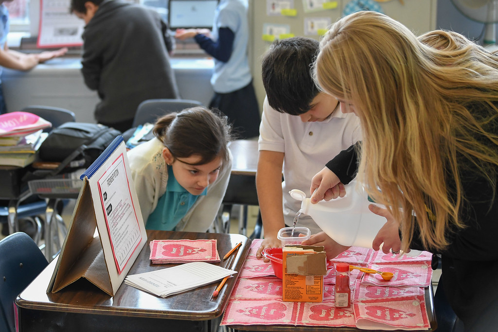 ". Eric Bonzar�The Morning Journal<br> Nine-year-old Bella Davis and 10-year-old Adrian Sams watch attentively as teacher Cassie Coley creates ""friendship potion,\"" during science class, Feb. 14, 2018."