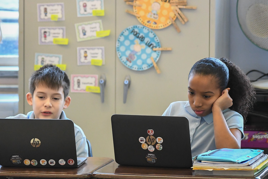 . Eric Bonzar�The Morning Journal<br> A pair of students work on laptops , during class, at Constellation Schools: Lorain Community Elementary and Middle, Feb. 14, 2018.