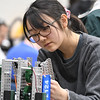 Eric Bonzar—The Morning Journal<br /> Seventeen-year-old Yui Ishihara, a junior at Shaker Heights' Laurel School, puts the finishing touches on her team's robot before competing in a VEX Robotics Qualifier competition, held at Lorain High School, Feb. 17, 2017.