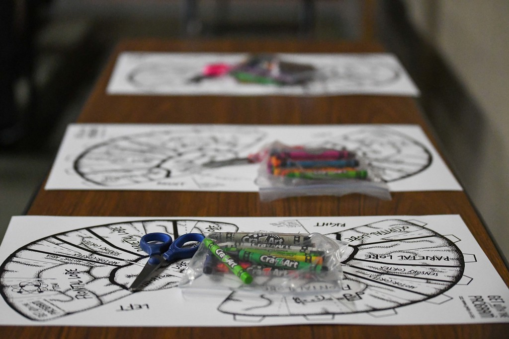 . Eric Bonzar�The Morning Journal<br> Children cut out, and colored each section of the brain to create a wearable brain hat during Get with the Program\'s Brain Games event, Feb. 19, 2018.