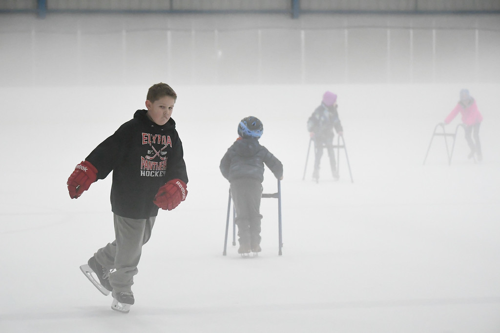 . Eric Bonzar�The Morning Journal<br> Eight-year-old Hunter Ryan, of Lorain, zips along the ice during North Park Ice Arena\'s holiday open skate, in Elyria, Feb. 19, 2018.