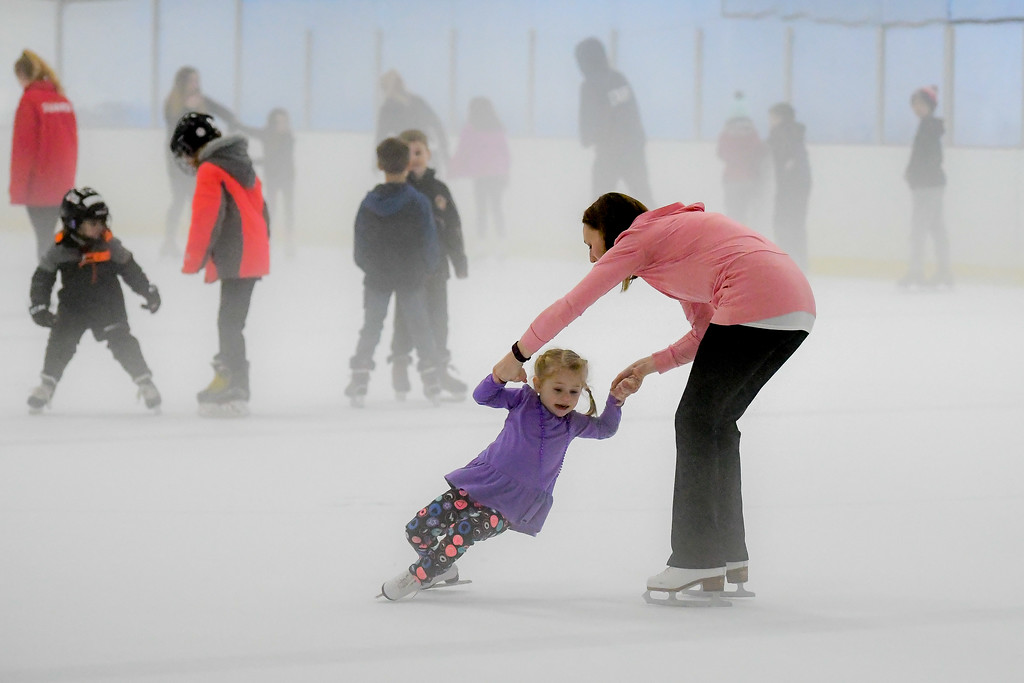 . Eric Bonzar�The Morning Journal<br> Three-year-old Annabelle Buzas holds on to her mother, Sarah Buzas, of Elyria, to keep from falling on the ice during North Park Ice Arena\'s holiday open skate, Feb. 19, 2018.