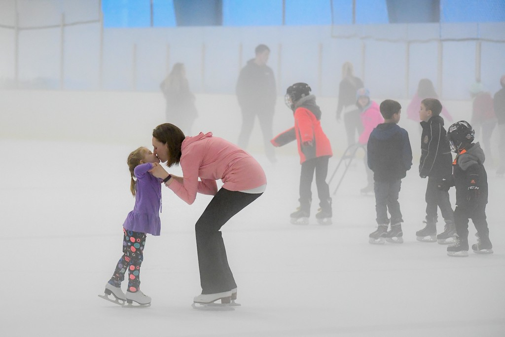 . Eric Bonzar�The Morning Journal<br> Three-year-old Annabelle Buzas shares a kiss with her mother, Sarah Buzas, of Elyria, during North Park Ice Arena\'s holiday open skate, Feb. 19, 2018.