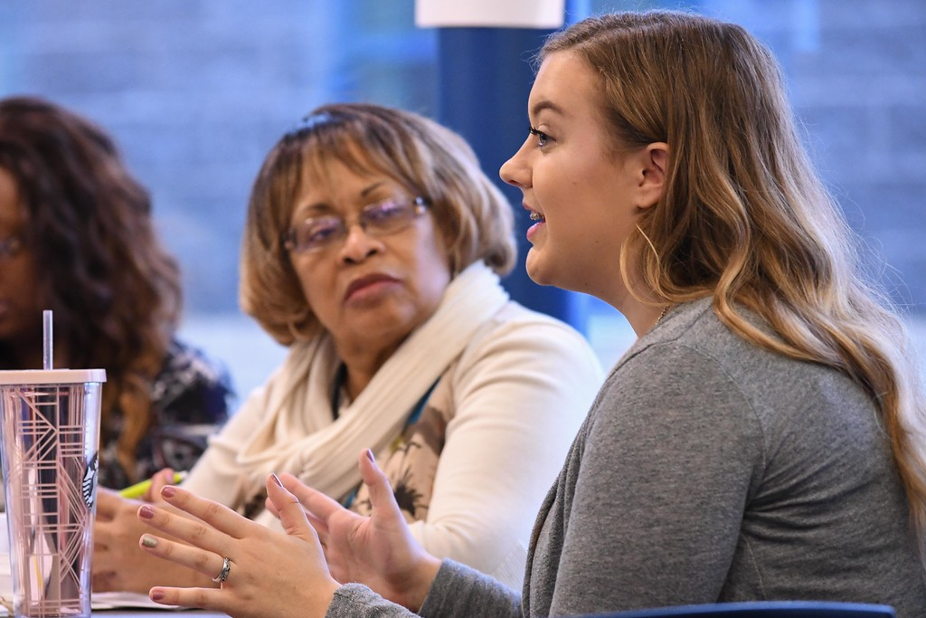 . Eric Bonzar�The Morning Journal<br> Newly elected school board member Yvonne Johnson listens to the ideas of 16-year-old junior Kaitlyn Ramey-Rowland during Lorain City Schools\' Community Business Schools partnership meeting, Feb. 21, 2018.