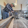 Eric Bonzar—The Morning Journal<br /> Bob Leimbach, vice president of the Brownhelm Historical Association and a former student of Brownhelm School, cuts wainscoting to length, Feb. 27, 2017. Leimbach, members of the historical association, and residents of the small community have come together to restore the school, which closed its doors in 1988.