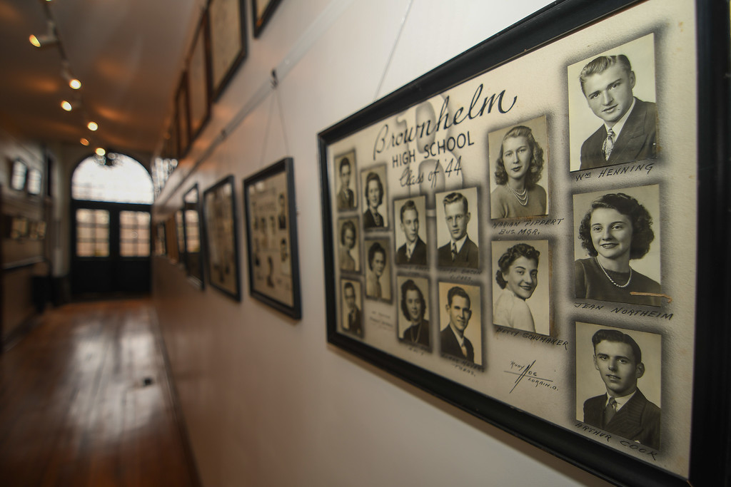 . Eric Bonzar�The Morning Journal The main hallway of the former Brownhelm school is lined with pictures of graduating classes from throughout the school\'s history.