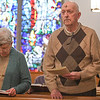 Eric Bonzar—The Morning Journal<br /> Parishioners Gloria and Brian French, of North Ridgeville, sing a hymn during a noon, Ash Wednesday service at the Episcopal Church of the Redeemer, 647 Reid Ave., March 1, 2017.
