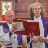 Eric Bonzar—The Morning Journal<br /> Reverend Jimmy Madsen, of the First Evangelical Lutheran Church, and Rev. Susan Tiffany, interim rector for the Episcopal Church of the Redeemer, read scripture during a noon, Ash Wednesday service at the Episcopal Church of the Redeemer, 647 Reid Ave., March 1, 2017.