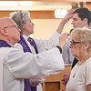 Eric Bonzar—The Morning Journal<br /> Reverend Jimmy Madsen, of the First Evangelical Lutheran Church, and Rev. Susan Tiffany, interim rector for the Episcopal Church of the Redeemer, apply ashes to parishioners' foreheads during a noon, Ash Wednesday service at the Episcopal Church of the Redeemer, 647 Reid Ave., March 1, 2017.