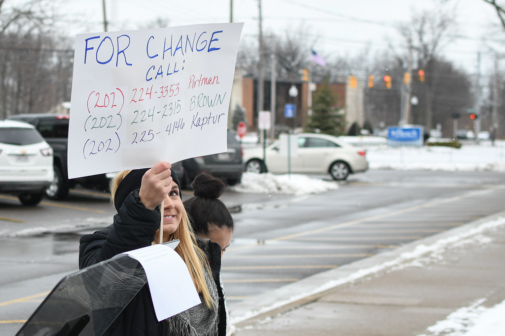 . Eric Bonzar�The Morning Journal<br> Avon Lake High School junior Allison Yellets, 17, holds up a sign with the phone numbers of state representatives Rob Portman, Sherrod Brown and Marcy Kaptur during a walkout at the high school, March 9, 2018, in response to the Parkland, Fla. school shooting.
