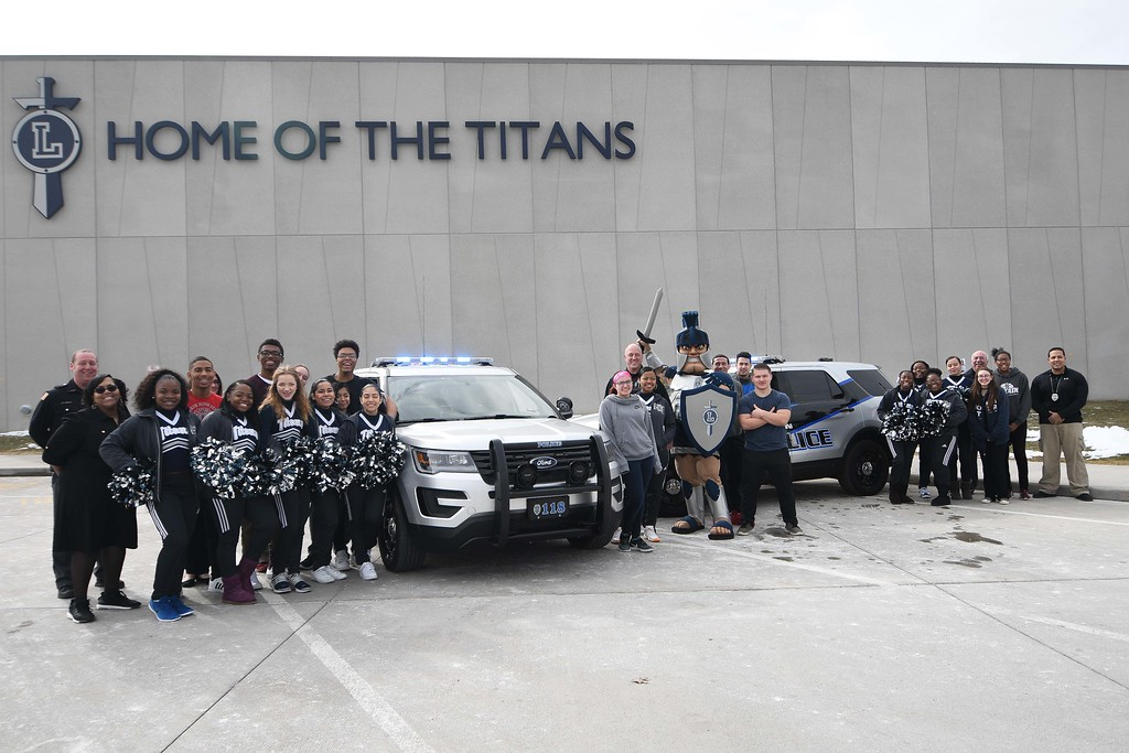. Eric Bonzar�The Morning Journal<br> On March 12, 2018, Lorain police came to Lorain High School to show their Titan pride. The department has added six new vehicles to their fleet, including two Ford Explorers designated for road patrol, with a new color scheme. The department chose to forego its standard black vehicle emblazoned with the yellow police shield and accents, for Lorain City Schools\' silver and navy blue.