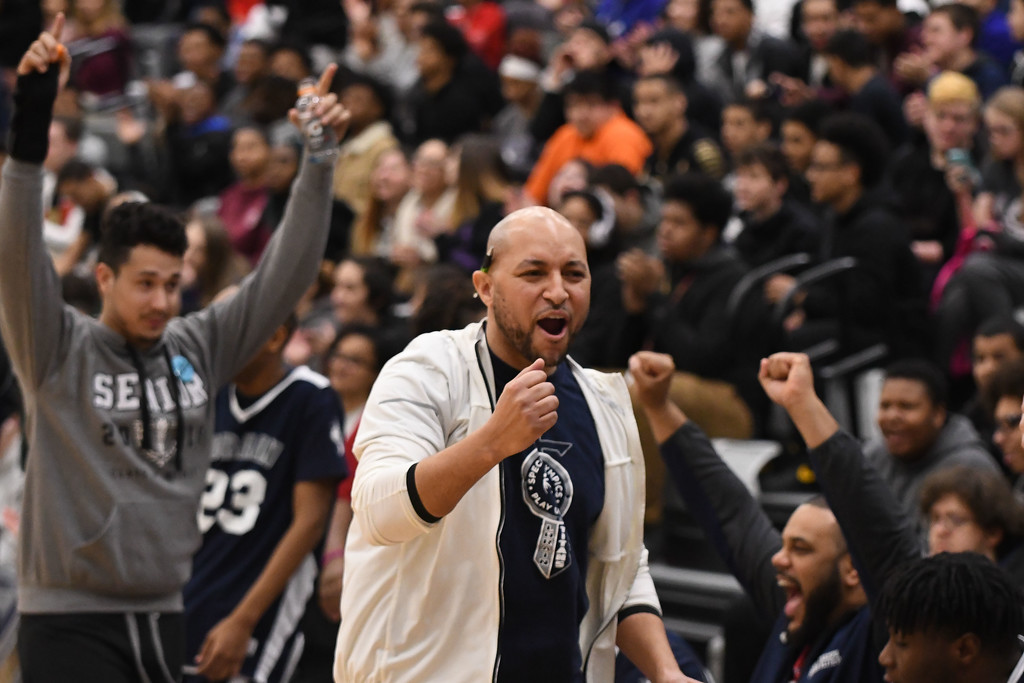. Eric Bonzar�The Morning Journal<br> Coach Matt Kielian pumps his fist in the air as his team beats John Marshall in the first game of the Unified Special Olympics Basketball Tournament, held at Lorain High School, March 21, 2018.