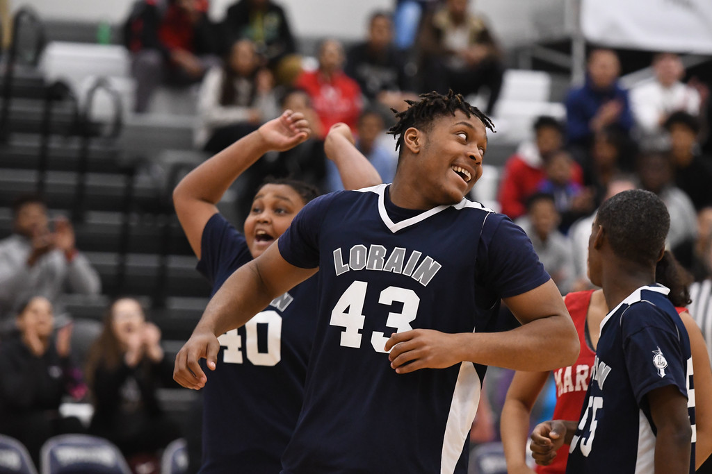. Eric Bonzar�The Morning Journal<br> The Lorain Titans celebrate a win during the Unified Special Olympics Basketball Tournament, held at Lorain High School, March 21, 2018.