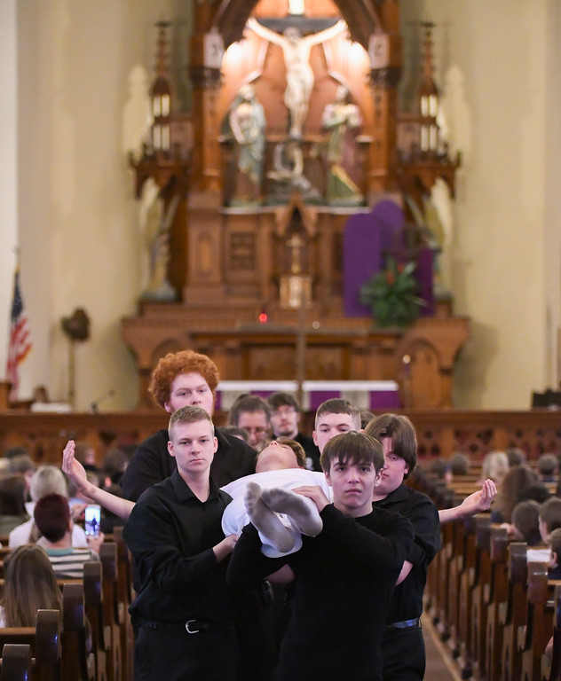 . Eric Bonzar�The Morning Journal<br> Elyria Catholic High School students perform �The Living Stations of the Cross� at Holy Trinity Catholic Parish, in Avon, March 27, 2018.