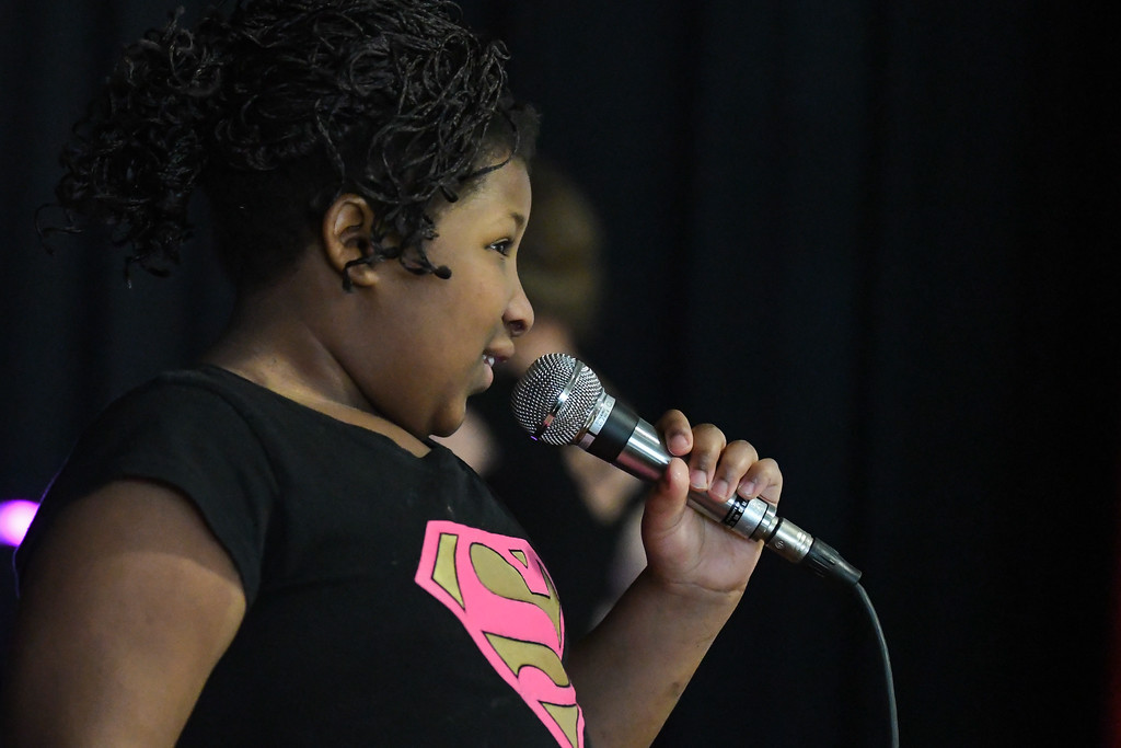 ". Eric Bonzar�The Morning Journal Murray Ridge student Diane Davis sings ""Kill them with Kindness\"" during the school\'s fifth annual talent show, March 29, 2017."
