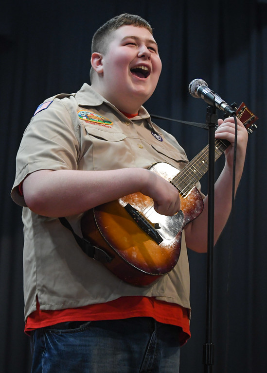 . Eric Bonzar�The Morning Journal Murray Ridge student Brandon Rivera, 16, sings the Boy Scout Camp Song during the school\'s fifth annual talent show, March 29, 2017.