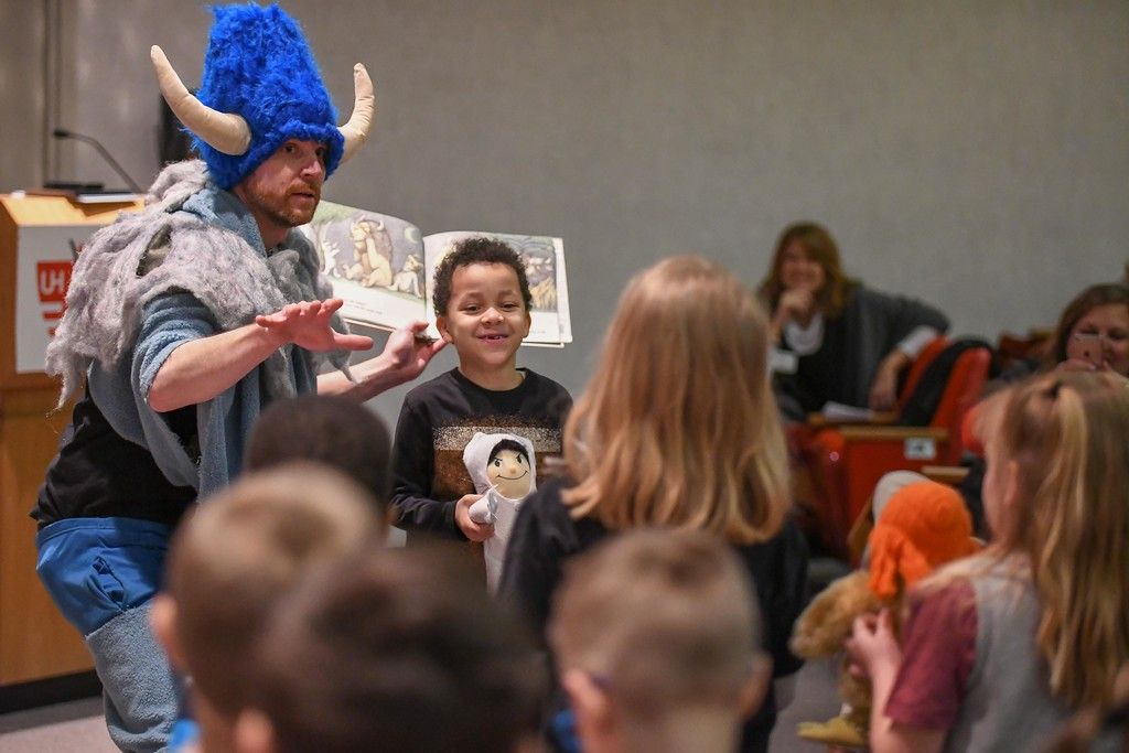 """. Eric Bonzar�The Morning Journal McKinley Elementary School first-grader Ashton Redding, 7, portrays \""""Max\"""" as he, his fellow classmates and children\'s author and illustrator Eric VanRaepenbusch act out Maurice Sendak\'s Where the Wild Things Are, during the unveiling of the Little Free Library at UH Elyria Medical Center, April 10, 2018."""