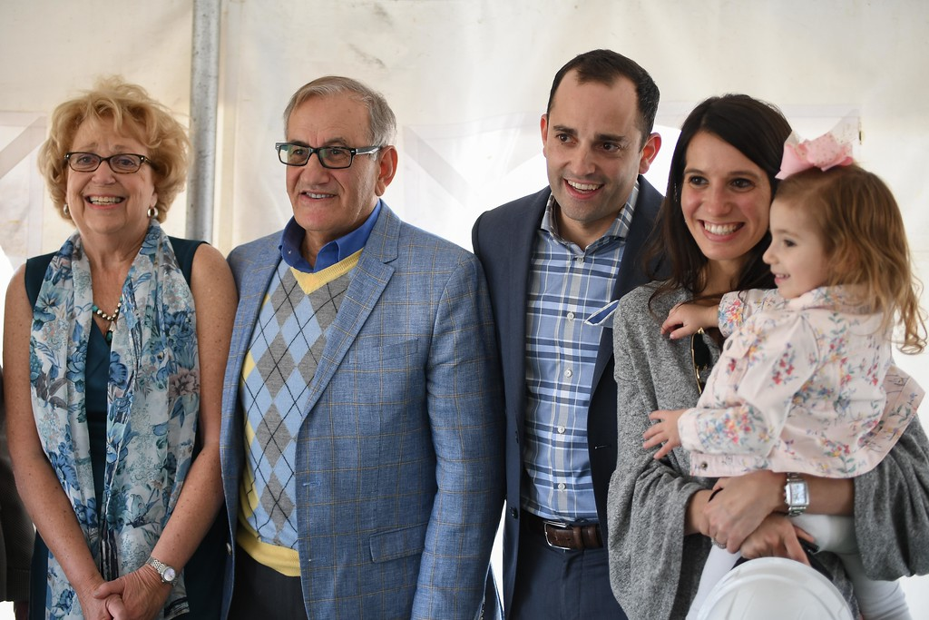 . Eric Bonzar�The Morning Journal<br> From left: Bitar family members Sandra, J.C., Bryant, Krystina and 2-year-old Audriana pose for photos during the ground breaking of Mercy Health\'s new Oak Point Medical Center, April 12, 2018. The Bitar family donated the land, which they have held in their family, for 50 years.