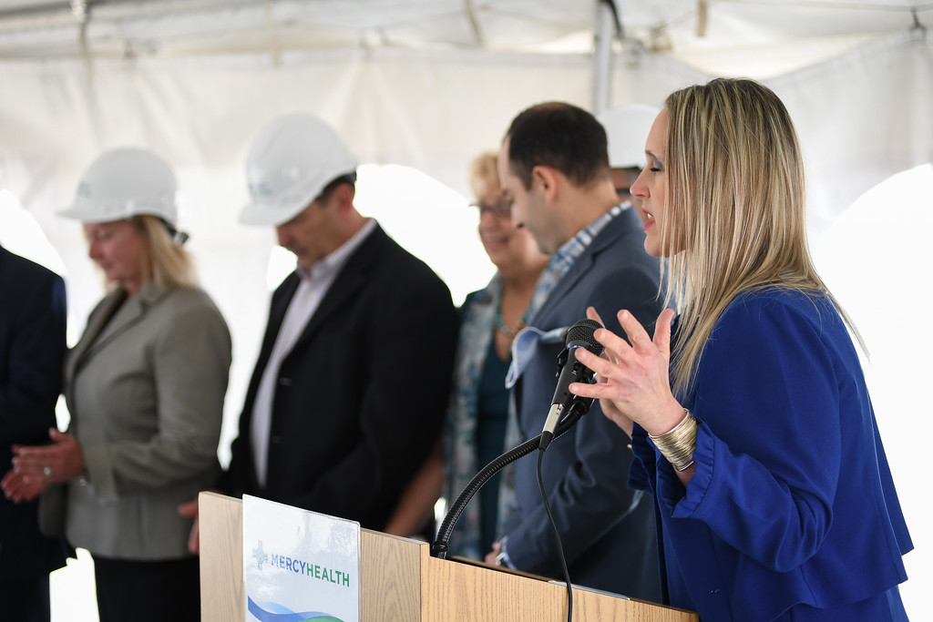 . Eric Bonzar�The Morning Journal<br> Catherine Woskobnick, vice president of mission and values integration at Mercy Health, blesses the land during the ground breaking of the health care provider\'s new Oak Point Medical Center, April 12, 2018.