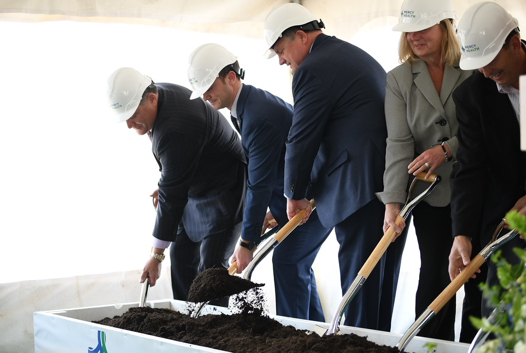 . Eric Bonzar�The Morning Journal<br> Public officials, board members and Mercy Health Senior Vice President and CEO Ed Oley, third from left, break ground on Mercy Health\'s new Oak Point Medical Center, April 12, 2018.