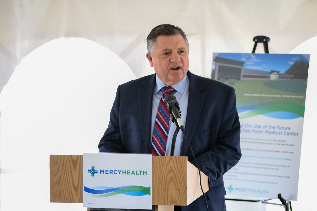 ". Eric Bonzar�The Morning Journal<br> Ed Oley, senior vice president and CEO of Mercy Health, speaks during the ground breaking of the health care provider\'s new Oak Point Medical Center, April 12, 2018. Oley said the new state-of-the art medical facility will be ""an investment in the community that will be everlasting and sustainable.\"""