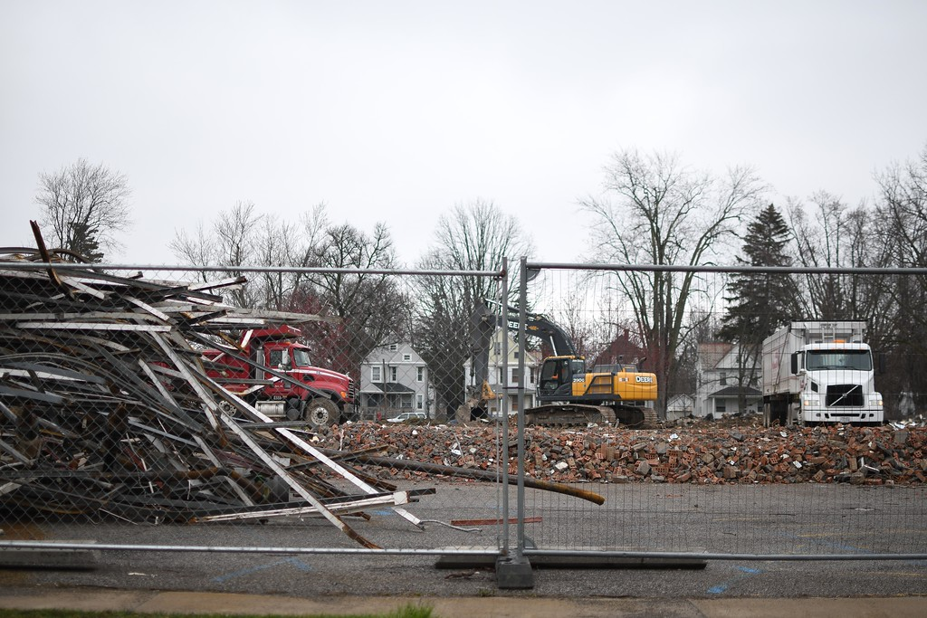 . Eric Bonzar�The Morning Journal<br> A crew cleans up scrap, April 16, 2018, from the former home of the Elyria Public Library System\'s South Branch and Lorain County Community Action Agency Head Start, located at 1215 Middle Ave.