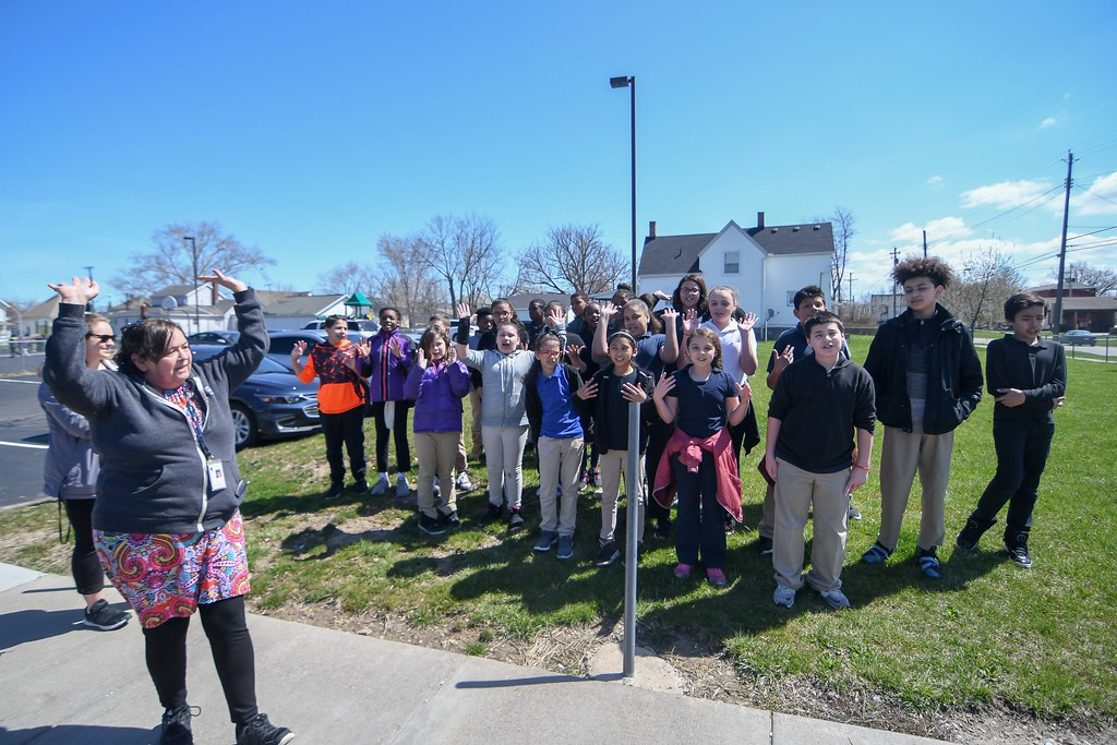 """. Eric Bonzar�The Morning Journal<br> Scholars at Garfield elementary School welcome the Morning Journal to their school with a song, April 26, 2018. In recognition of Pay it Forward Day, and in honor of Lorain native and Garfield Elementary School alumna Theresa \""""Tippie\"""" Moon and the To the Moon & Back Foundation, the fifth-grade scholars picked up trash around their school and neighborhood."""