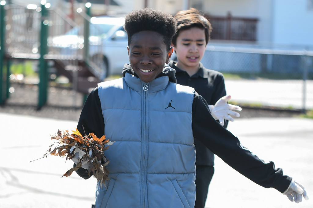 """. Eric Bonzar�The Morning Journal<br> In recognition of Pay it Forward Day, and in honor of Lorain native and Garfield Elementary School alumna Theresa \""""Tippie\"""" Moon and the To the Moon & Back Foundation, fifth-grade scholars at Garfield Elementary School pick up trash around their school and neighborhood, April 26, 2018."""
