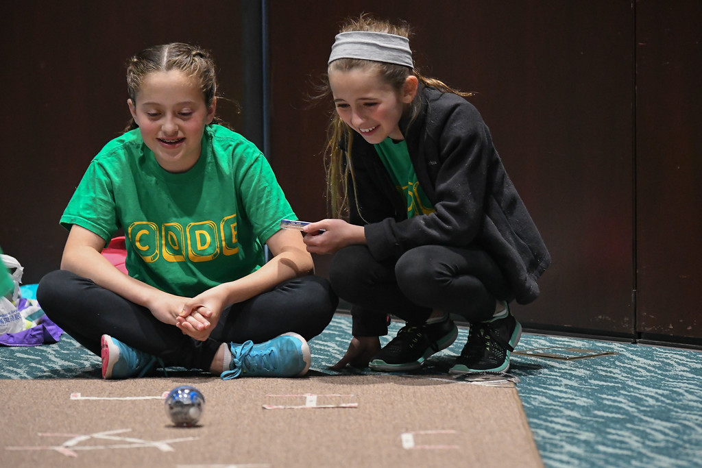 . Eric Bonzar�The Morning Journal Ten-year-old Jillian George, left, and Gianna Vrooman, 11, demonstrate how to operate their Sphero, May 4, 2017. The fifth graders from Amherst School Districts\' STEAM Team were on hand for demonstrations during the fourth annual Lorain County Superintendent Summit, held at the Lorain County Community College John A. Spitzer Conference Center, May 4, 2017.