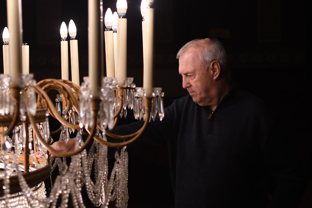 . Eric Bonzar�The Morning Journal<br> Ken Kramer, president of the Lorain Palace Theater board of directors, inspects the theater\'s chandelier, March 7, 2018. Staff lowered the 3/4 ton, 87 bulb, Yugoslavian cut crystal chandelier for maintenance.
