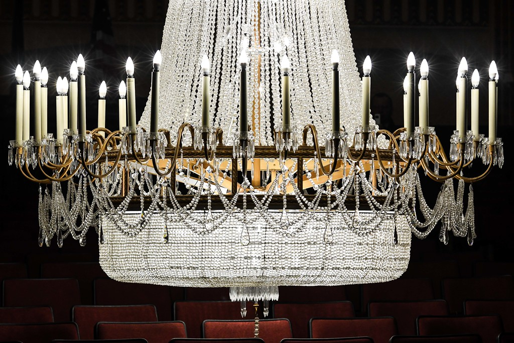 . Eric Bonzar�The Morning Journal<br> Staff of the Lorain Palace Theater lowered its 3/4 ton, 87 bulb, Yugoslavian cut crystal chandelier for maintenance, March 7, 2018. The theater plans to leave the chandelier down until about March 22, and encourage fans to stop by from 9 a.m. to 3 p.m., Tues. through Friday to see it up close and personal.