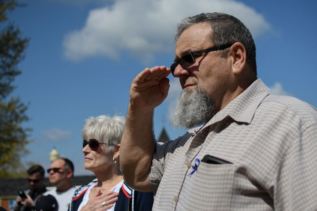 . Eric Bonzar�The Morning Journal<br> Wellington resident, and retired Elyria police Officer Al Leiby salutes as the American flag is raised to half-mast during the Lorain County Police Memorial, held at Howk Memorial Park, in Wellington, May 10, 2018.