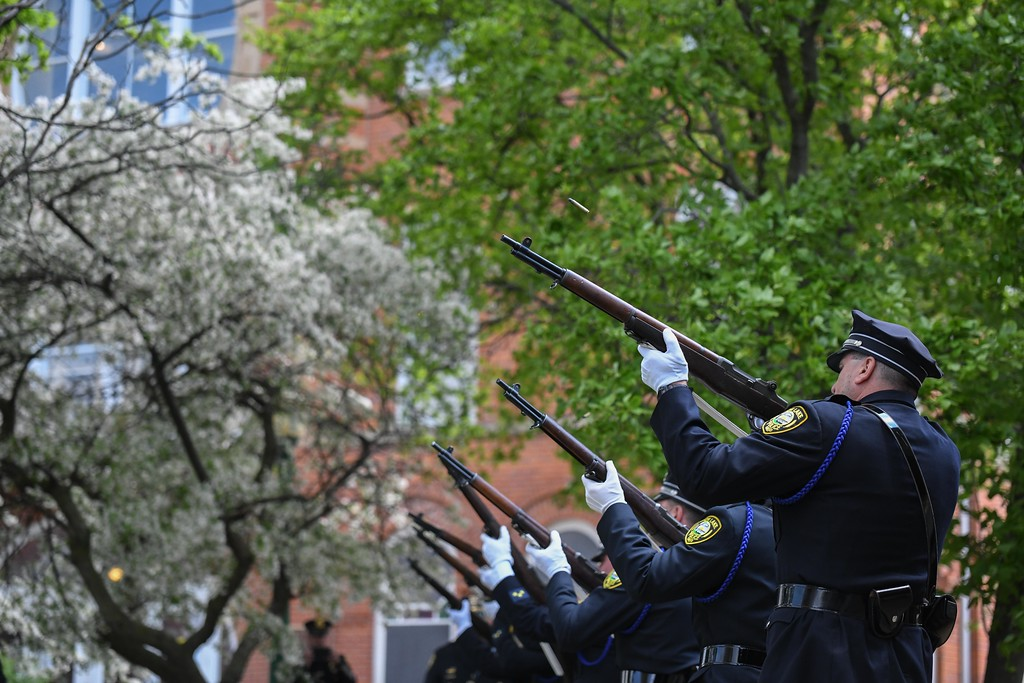 . Eric Bonzar�The Morning Journal<br> Members of the Avon Lake Police Department Honor Guard perform a rifle salute during the Lorain County Police Memorial, held at Howk Memorial Park, in Wellington, May 10, 2018.