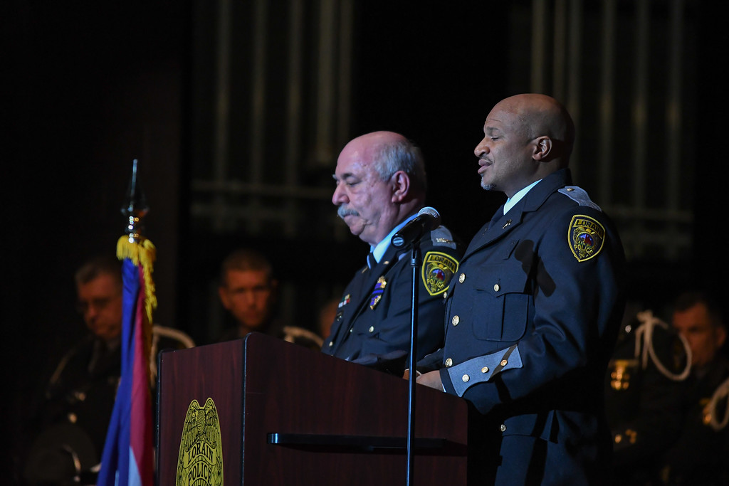 . Eric Bonzar�The Morning Journal Lorain Police Department Chaplain Pastor Tim Williams opens the Lorain County Police Memorial Service, with an invocation, alongside Lorain police Chief Cel Rivera, May 11, 2017.