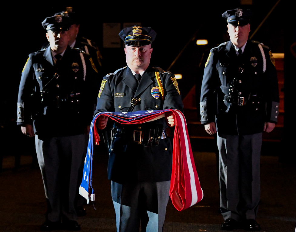 . Eric Bonzar�The Morning Journal Sergeant Robert Brown and the Lorain Police Department Honor Guard present the memorial flag of the fallen during the Lorain County Police Memorial Service, May 11, 2017.