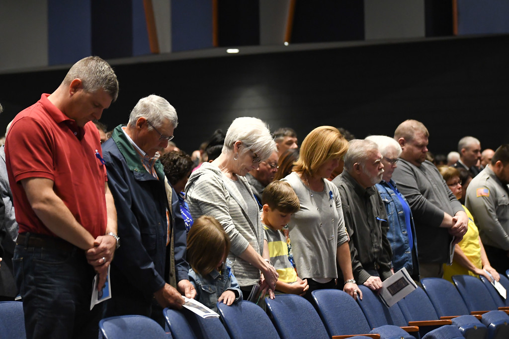 . Eric Bonzar�The Morning Journal Attendees of the Lorain County Police Memorial Service bow their heads in prayer, May 11, 2017.