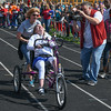Eric Bonzar—The Morning Journal<br /> Sixteen-year-old Midview student Amanda Ashmun competes in the 50 meter race, with the assistance of Jody Anderson, during the 36th annual Lorain County Special Olympics, May 13, 2016.