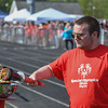 Eric Bonzar—The Morning Journal<br /> Elyria High School senior William Caldwell kicks off the 36th annual Lorain County Special Olympics, with the lighting of the torch, May 13, 2016.