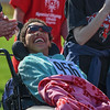 Eric Bonzar—The Morning Journal<br /> Elyria High School Homecoming Queen Elna Wright is all smiles as she and the Elyria Sign Choir sing and sign to family and friends during the 36th annual Lorain County Special Olympics, May 13, 2016.